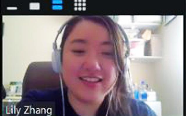 Lily Zhang in zoom meeting with headphones